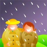 Pares en la lluvia Imagenes de archivo