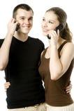 Pares en los teléfonos Foto de archivo