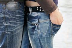 Pares en pantalones vaqueros Imagen de archivo libre de regalías