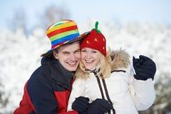 Pares felices de la familia en invierno Foto de archivo libre de regalías