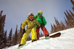 Pares felices de la snowboard Imagen de archivo