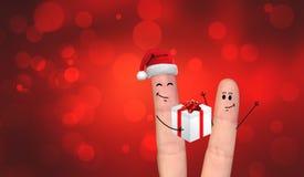 Pares felices del finger en el amor que celebra Navidad Imagen de archivo