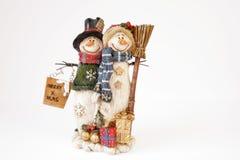 Pares felices del muñeco de nieve fotografía de archivo