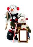 Pares felices del muñeco de nieve con un marco en blanco Imagenes de archivo
