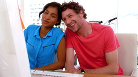 Happy business couple working on a computer Stock Footage