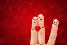 Pares felices en amor y la tercera rueda Imágenes de archivo libres de regalías