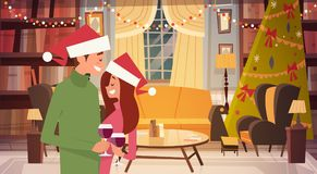 Pares felices en el sitio de Santa Hats Embracing In Living adornado por Feliz Navidad y Feliz Año Nuevo stock de ilustración