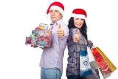 Pares felizes bem sucedidos com presentes do Natal Imagem de Stock Royalty Free