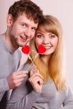 Pares felizes bonitos com corações Imagem de Stock Royalty Free