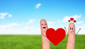 Pares felizes do dedo no amor que comemora o dia de são valentim Imagens de Stock