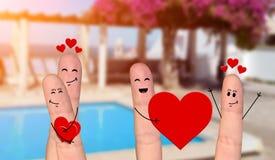 Pares felizes do dedo no amor que comemora o dia de são valentim Imagem de Stock