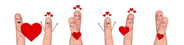 Pares felizes do dedo no amor que comemora o dia de são valentim Fotos de Stock Royalty Free
