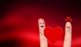 Pares felizes do dedo no amor que comemora o dia de são valentim Fotografia de Stock