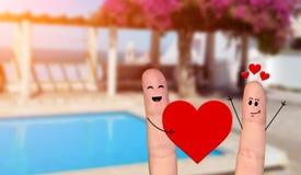 Pares felizes do dedo no amor que comemora o dia de são valentim Imagens de Stock Royalty Free