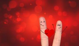 Pares felizes do dedo no amor que comemora o Xmas Imagens de Stock Royalty Free