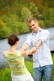 Pares felizes em um lago Fotografia de Stock