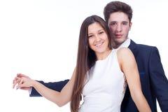 Pares felizes que abraçam e que beijam Imagens de Stock