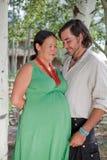 Pares felizes que esperam um bebê Foto de Stock