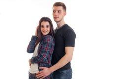 Pares gay jovenes que se unen y muchacha sonriente Imagenes de archivo