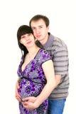 Pares grávidos felizes bonitos novos Fotografia de Stock