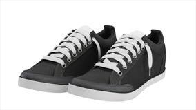 Pares gris oscuro de zapatillas de deporte del deporte Imagen de archivo