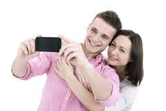 Pares jovenes atractivos que toman un selfie junto Imágenes de archivo libres de regalías