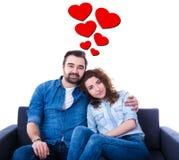 Pares jovenes en amor aislados en blanco Foto de archivo libre de regalías
