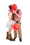 Pares jovenes en el beso del traje del carnaval - aislado en el backgr blanco Fotos de archivo libres de regalías
