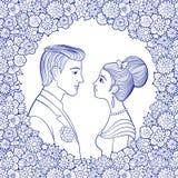 Pares jovenes en marco floral decorativo Imágenes de archivo libres de regalías