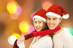 Pares jovenes felices de la Navidad Imagen de archivo