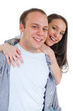 Pares jovenes que abrazan y que sonríen fotografía de archivo libre de regalías