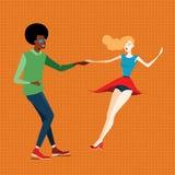 Pares jovenes que bailan el salto lindy Foto de archivo