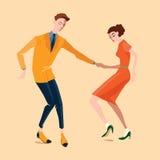Pares jovenes que bailan el salto lindy Imagen de archivo
