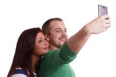 Pares jovenes que toman el selfie Fotos de archivo libres de regalías