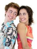Pares jovenes sonrientes Imágenes de archivo libres de regalías