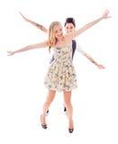 Pares lesbianos que se colocan con el brazo extendido Fotos de archivo