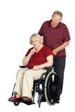 Pares mayores con la mujer en sillón de ruedas Foto de archivo libre de regalías