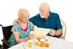 Pares mayores - cuentas médicas Foto de archivo libre de regalías