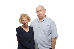 Pares mayores que hacen caras Imagen de archivo