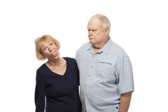 Pares mayores que hacen caras Foto de archivo libre de regalías