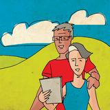 Pares mayores usando una tableta Fotos de archivo