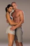Pares muito sedutores na pose da aptidão do corpo Imagem de Stock Royalty Free