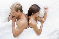 Pares na cama adormecida Fotografia de Stock Royalty Free