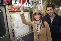 Pares na moda novos no metro de New York Fotos de Stock Royalty Free