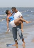 Pares na praia Fotos de Stock Royalty Free