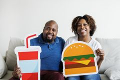 Pares negros con los iconos de la comida Imagen de archivo libre de regalías