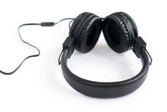 Pares negros de auriculares Fotos de archivo libres de regalías