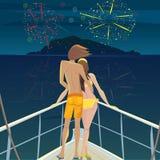 Pares no navio que admira os fogos-de-artifício sobre a ilha Fotografia de Stock Royalty Free