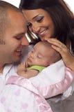 Pares novos da raça misturada com bebê recém-nascido Fotos de Stock Royalty Free