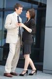 Pares novos elegantes do negócio Imagens de Stock Royalty Free